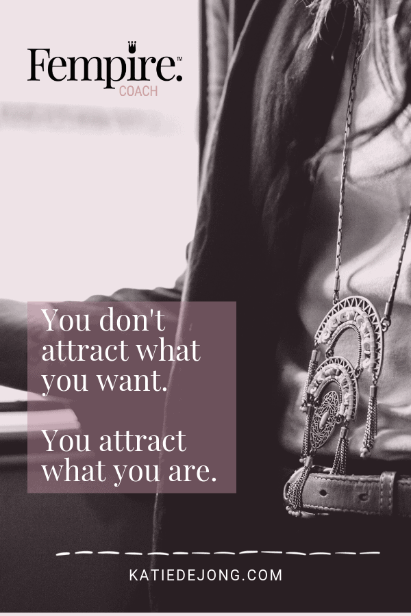 Woman wearing necklace standing by window with text overlay - You don't attract what you want. You attract what you are.