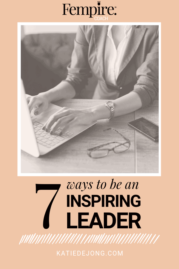 woman working at a computer - text overlay 7 ways to be an inspiring leader