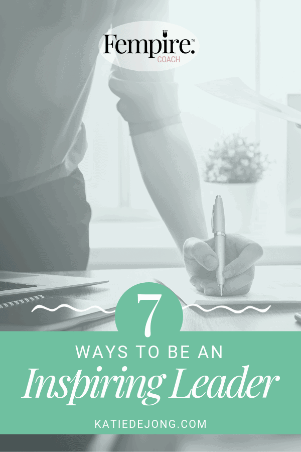 woman writing at desk - text overlay 7 ways to be an inspiring leader